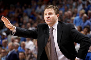 photo - Oklahoma City coach Scott Brooks shouts during an NBA basketball game between the Oklahoma City Thunder and the Minnesota Timberwolves at Chesapeake Energy Arena in Oklahoma City, Friday, March 23, 2012. Photo by Bryan Terry, The Oklahoman
