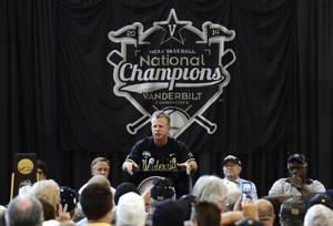 Photo - Vanderbilt head coach Tim Corbin speaks during the victory celebration for the team's first baseball NCAA College World Series national championship at Vanderbilt University on Thursday, June 26, 2014, in Nashville, Tenn.  (AP Photo/Mark Zaleski)