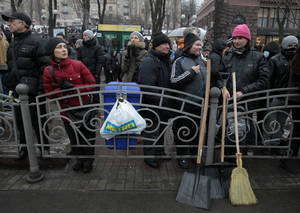Photo - Demonstrators angered by more than two months of anti-government protests in Kiev gather on  Khreschatyk street in  Kiev, Ukraine,  Saturday, Feb. 8, 2014. Thousands of people angered by months of anti-government protests in the Ukrainian capital converged on one of the protesters' barricades Saturday, but retreated after meeting sizeable resistance. (AP Photo/Sergei Chuzavkov)