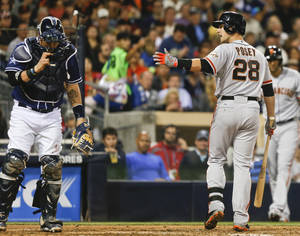 Photo - San Francisco Giants' Buster Posey argues with home plate umpire Gabe Morales after being called out on strikes in the seventh inning of a baseball game against the San Diego Padres, Saturday, April 19, 2014, in San Diego. (AP Photo/Lenny Ignelzi)