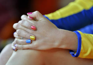 Photo - Sweden's Moa Hjelmer, her nails painted in a variety of colors, watches the women's 200-meter final at the World Athletics Championships in the Luzhniki stadium in Moscow, Russia, Friday, Aug. 16, 2013. (AP Photo/Martin Meissner)