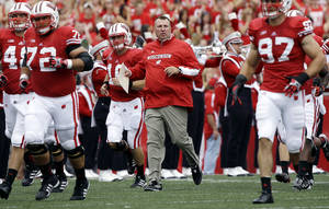 Photo -   Wisconsin head coach Bret Bielema leads his team on the field before the first half of an NCAA college football game against Northern Iowa Saturday, Sept. 1, 2012, in Madison, Wis. (AP Photo/Morry Gash)