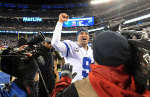 Photo - File - In this Nov. 24, 2013 file photo, Dallas Cowboys quarterback Tony Romo (9) gestures while leaving the field after defeating the New York Giants 24-12 in an NFL football game, in East Rutherford, N.J. The winter blast that hit North Texas forced the Cowboys indoors when they were hoping to keep working outside in preparation for a bitterly cold Monday night in Chicago. The Cowboys don't mind practicing in the elements because it worked pretty well leading up to a frigid win at the New York Giants two weeks ago. (AP Photo/Bill Kostroun, File)