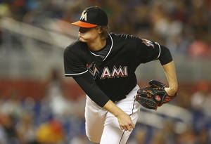 Photo - Miami Marlins starter Tom Koehler pitches to the New York Mets during the second inning of a baseball game in Miami, Saturday, June 21, 2014. (AP Photo/J Pat Carter)