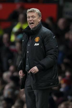 Photo - Manchester United's manager David Moyes issues instructions during his team's English League Cup semifinal second leg soccer match against Sunderland at Old Trafford Stadium, Manchester, England, Wednesday Jan. 22, 2014. (AP Photo/Jon Super)