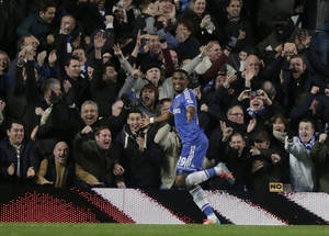 Photo - Chelsea's Samuel Eto'o, left, celebrates after his hat-trick against Manchester United during the English Premier League soccer match between Chelsea and Manchester United at Stamford Bridge stadium in London, Sunday, Jan. 19, 2014. (AP Photo/Matt Dunham)
