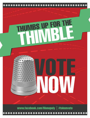 Photo - A poster encouraging people to vote for the thimble gamepiece is shown.  AP Photo