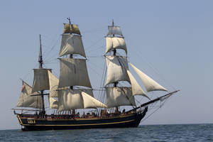 Photo -   FILE - In this July 7, 2010 file photo, the tall ship HMS Bounty sails on Lake Erie off Cleveland. The U.S. Coast Guard has rescued 14 members of the crew forced to abandon the HMS Bounty caught in Hurricane Sandy off North Carolina. The Coast Guard is searching for two other crew members. (AP Photo/Mark Duncan, File)