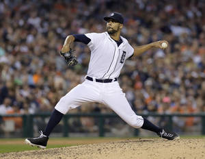Photo - Detroit Tigers pitcher David Price delivers against the Seattle Mariners during the fifth inning of a baseball game Saturday, Aug. 16, 2014, in Detroit. (AP Photo/Duane Burleson)