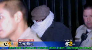 Photo -   FILE - In this Sept. 15, 2012 file image from video provided by CBS2-KCAL9, Nakoula Basseley Nakoula, the man behind a crudely produced anti-Islamic video that has inflamed parts of the Middle East, is escorted by Los Angeles County sheriff's deputies from his home in Cerritos, Calif. Nakoula, 55, was arrested Thursday for violating terms of his probation, authorities said. (AP Photo/CBS2-KCAL9, File) MANDATORY CREDIT CBS-KCAL9, LOS ANGELES OUT, LOS ANGELES TV OUT