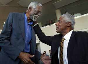 Photo - Julius Erving, right, former Philadelphia 76ers basketball great, greets former Boston Celtics basketball star Bill Russell after a statue honoring Russell was unveiled at City Hall Plaza in Boston, Friday, Nov. 1, 2013. (AP Photo/Elise Amendola)