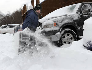 photo - Richard Effinger, 43, digs his truck out from the snow Saturday morning, Feb. 9, 2013 in Danbury, Conn. A behemoth storm packing hurricane-force wind gusts and blizzard conditions swept through the Northeast overnight. (AP Photo/The News-Times, Carol Kaliff) MANDATORY CREDIT: THE NEWS-TIMES, CAROL KALIFF