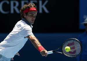 Photo - Roger Federer of Switzerland makes a backhand return to James Duckworth of Australia during their first round match at the Australian Open tennis championship in Melbourne, Australia, Tuesday, Jan. 14, 2014.(AP Photo/Eugene Hoshiko)