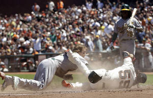 Photo -   Oakland Athletics' Collin Cowgill, left, collides at home plate with San Francisco Giants starting pitcher Tim Lincecum (55) after a wild pitch during the fourth inning of an interleague baseball game in San Francisco, Sunday, May 20, 2012. Cowgill scored on the play. (AP Photo/Marcio Jose Sanchez)