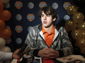Photo - Oklahoma State senior quarterback Clint Chelf speaks to the media during an NCAA college football press conference, Wednesday, Jan. 1, 2014, in Irving, Texas. Oklahoma State takes on Missouri in the Cotton Bowl on Friday in Arlington, Texas. (AP Photo/Brandon Wade)