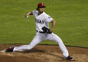 Photo -   Texas Rangers' Yu Darvish of Japan delivers to the Seattle Mariners in the fifth inning of a baseball game Friday, Sept. 14, 2012, in Arlington, Texas. (AP Photo/Tony Gutierrez)