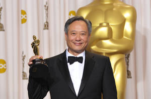 "Photo - Ang Lee poses with his award for best directing for ""Life of Pi"" during the Oscars at the Dolby Theatre on Sunday Feb. 24, 2013, in Los Angeles. (Photo by John Shearer/Invision/AP)"