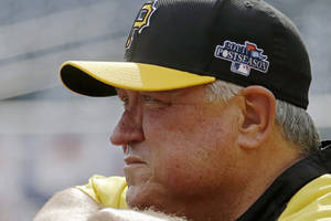 Photo - Pittsburgh Pirates manager Clint Hurdle leans on the batting cage as he watches batting practice before Game 3 of a National League Division Baseball Series on Sunday, Oct. 6, 2013 in Pittsburgh , PA (AP Photo/Gene J. Puskar)
