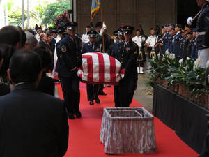 photo - Pallbearers carry the casket of U.S. Sen. Daniel Inouye into the courtyard of the Hawaii state Capitol during a visitation ceremony in Honolulu on, Saturday Dec. 22, 2012. (AP Photo/Oskar Garcia)