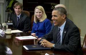Photo - President Barack Obama meets with technology executives in the Roosevelt Room of the White House in Washington, Tuesday, Dec. 17, 2013. From left are, Mark Pincus, founder, Chief Product Officer & Chairman, Zynga; Marissa Mayer, President and CEO, Yahoo!, and Obama. (AP Photo/ Evan Vucci)