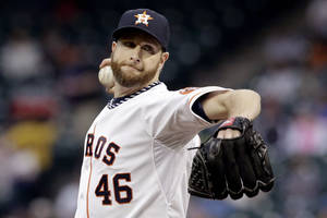 Photo - Houston Astros' Scott Feldman delivers a pitch against the Kansas City Royals in the first inning of a baseball game on Thursday, April 17, 2014, in Houston. (AP Photo/Pat Sullivan)