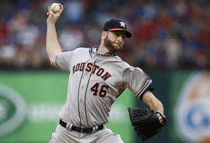 Photo - Houston Astros starting pitcher Scott Feldman (46) delivers to the Texas Rangers during the first inning of a baseball game, Friday, April 11, 2014, in Arlington, Texas. (AP Photo/Jim Cowsert
