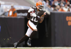 photo - FILE - In this Nov. 4, 2012, file photo, Cleveland Browns wide receiver Josh Cribbs (16) runs the ball on a kickoff return against the Baltimore Ravens in the first half of an NFL football game in Cleveland. Cribbs doesn't like the possibility that the NFL will replace the kickoff. Commissioner Roger Goodell said this week that the league's competition committee will consider eliminating the kickoff in the offseason.  (AP Photo/Rick Osentoski, File)