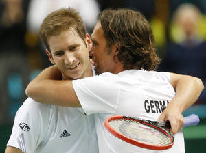 Photo - Germany's Florian Mayer, left, celebrates with team captain Carsten Arriens after beating Spain's Feliciano Lopez during a Davis Cup World Group first round tennis match between Germany and Spain in Frankfurt, Germany, Friday, Jan. 31, 2014. (AP Photo/Michael Probst)