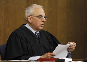 photo -   Cuyahoga County Judge Stuart Friedman reads his ruling on a death penalty case in Cleveland, Friday, June 15, 2012. Friedman ruled that condemned murderer Abdul Awkal is not mentally competent to be executed for the death of his estranged wife and brother-in-law in 1992. The decision comes just a week after Ohio Gov. John Kasich ordered a last-minute reprieve, hours before Awkal was set to die. (AP Photo/Mark Duncan)