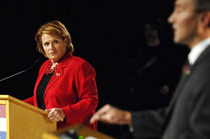 photo -   Democratic candidate for the North Dakota's U.S. Senate seat, Heidi Heitkamp, looks to Republican candidate U.S. Rep. Rick Berg, R-N.D., during a debate in Bismarck, N.D., on Thursday, Oct. 25, 2012. (AP Photo/Will Kincaid)