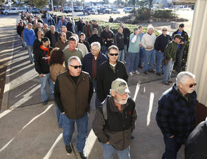 photo - Gun enthusiasts line up outside the Expo Hall at State Fair Park in Oklahoma City, OK, to attend a gun show, Saturday, January 19, 2013,  By Paul Hellstern, The Oklahoman