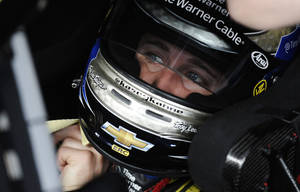 Photo - Driver Kasey Kahne sits in his car as he waits for a practice session to begin for Sunday's NASCAR Sprint Cup series auto race at the Talladega Superspeedway in Talladega, Ala., Friday, May 3, 2013. (AP Photo/Rainier Ehrhardt)