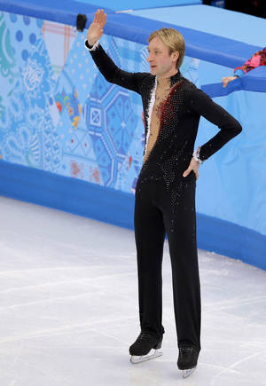 Photo - Evgeni Plushenko of Russia leaves the ice after pulling out of the men's short program figure skating competition due to illness at the Iceberg Skating Palace during the 2014 Winter Olympics, Thursday, Feb. 13, 2014, in Sochi, Russia. (AP Photo/Vadim Ghirda)