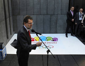 Photo - Spanish Prime Minister Mariano Rajoy speaks to the press after a meeting with the International Olympic Committee during the first day of an inspection tour for the candidate city of the 2020 Olympic Games in Madrid, Spain, Monday, March 18, 2013. (AP Photo/Andres Kudacki).