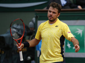 Photo - Switzerland's Stanislas Wawrinka reacts as he plays Spain's Guillermo Garcia-Lopez during their first round match of  the French Open tennis tournament at the Roland Garros stadium, in Paris, France, Monday, May 26, 2014. (AP Photo/Michel Euler)