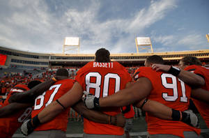 photo - CELEBRATION: Oklahoma State's Tracy Moore (87), Cooper Bassett (80) and James Castleman (91) celebrate following a college football game between the Oklahoma State University Cowboys (OSU) and the Baylor University Bears (BU) at Boone Pickens Stadium in Stillwater, Okla., Saturday, Oct. 29, 2011. Photo by Sarah Phipps, The Oklahoman  ORG XMIT: KOD