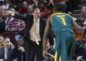 Photo - Baylor head coach Scott Drew directs guard Kenny Chery (1) in the second half of an NCAA college basketball game against Oklahoma in Norman, Okla., Saturday, Feb. 8, 2014. Oklahoma won 88-72. (AP Photo/Sue Ogrocki)