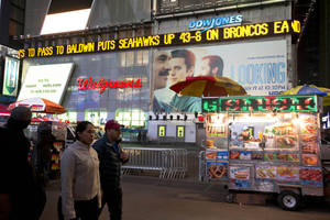Photo - A news ticker displays the score in Times Square after the Seattle Seahawks defeated the Denver Broncos in the NFL Super Bowl XLVIII football game, Sunday, Feb. 2, 2014, in New York. The Seahawks won 43-8. (AP Photo/Matt Rourke)