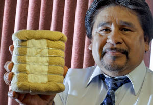 photo - Jorge Martinez, executive director of ORO Development Corp., holds a miniature cotton bale. ORO offers programs for Oklahoma's farm workers to train for other, higher-wage jobs. Photo by Chris Landsberger, The Oklahoman <strong>CHRIS LANDSBERGER</strong>