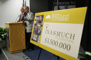 photo - 9:03 Fund co-chairs Mike Turpen, left, and John Richels announced a $3.5 million capital grant to the 9:03 Fund during a news conference at the Oklahoma City National Memorial & Museum in Oklahoma City, Thursday January 17, 2013. The Inasmuch Foundation's donation is the largest private gift in the institution's history. Photo By Steve Gooch