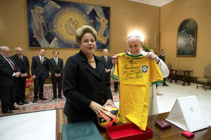 Photo - In this photo provided by the Vatican newspaper L'Osservatore Romano, Pope Francis exchanges gifts with Brazilian President Dilma Rousseff during their audience at the Vatican, Friday, Feb. 21, 2014.  (AP Photo/L'Osservatore Romano, ho)
