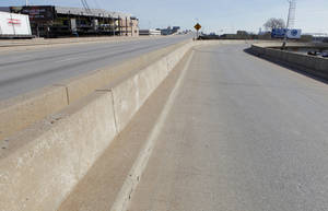 Photo - Eastbound lanes and Harvey off-ramp of the Interstate 40 Crosstown Expressway are no longer in use. Demolition of the bridge is set to begin this week. Photo by PAUL B. SOUTHERLAND, THE Oklahoman