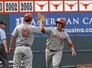 Photo - Texas's Mark Payton (2) celebrates after hitting a home run against Houston in the first inning of an NCAA college baseball tournament super regional game in  Austin, Texas, Friday, June 6, 2014.  (AP Photo/Michael Thomas)