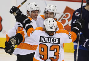 photo - Philadelphia Flyers&#039; Tye McGinn (15) celebrates his goal against the Winnipeg Jets with teammates Brayden Schenn (10) and Jakub Voracek (93) during the third period of an NHL hockey game in Winnipeg, Manitoba, Tuesday, Feb. 12, 2013. (AP Photo/The Canadian Press, Trevor Hagan)