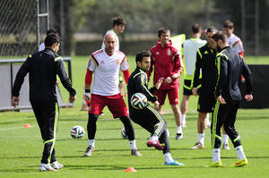 Photo - Spain's Cesc Fabregas, center, controls the ball during an official training session the day before the group B World Cup soccer match between Spain and Australia at the Atletico Paranaense training center in Curitiba, Brazil, Sunday, June 22, 2014. Spain will play in group B of the Brazil 2014 World Cup. (AP Photo/Manu Fernandez)