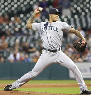 Photo - In his Major-League debut Seattle Mariners' Taijuan Walker delivers a pitch against the Houston Astros in the third inning of a baseball game Friday, Aug. 30, 2013, in Houston. (AP Photo/Pat Sullivan)