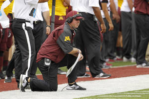 Photo - Minnesota head coach Jerry Kill kneels on the sidelines during the second quarter of an NCAA college football game against Western Illinois in Minneapolis, Saturday, Sept. 14, 2013. (AP Photo/Ann Heisenfelt)