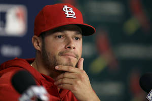 Photo - St. Louis Cardinals pitcher Joe Kelly ponders a question during a news conference Thursday, Oct. 10, 2013, in St. Louis. Kelly will be the Cardinals' starter for Game 1 of the NLCS against the Los Angeles Dodgers scheduled for Friday in St. Louis. (AP Photo/Jeff Roberson)