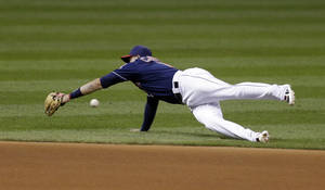 Photo - Cleveland Indians shortstop Asdrubal Cabrera dives for a single hit by Baltimore Orioles shortstop J.J. Hardy in the fifth inning of a baseball game, Tuesday, Sept. 3, 2013, in Cleveland. (AP Photo/Tony Dejak)