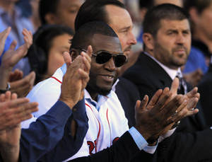 Photo -   Boston Red Sox's David Ortiz, center front, applauds with former Red Sox players Tim Wakefield, center right, and Jason Varitek, right, during ceremonies held to honor the life of the late Johnny Pesky at Fenway Park, in Boston, Sunday, Sept. 23, 2012. Pesky, who died in August at the age of 92, was a player, manager, and coach for the team. (AP Photo/Steven Senne)